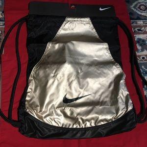 Nike black and gold drawstring bag
